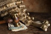 Bribery or corruption in court symbolized with money and a judge's wig