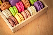 traditional french colorful macarons in a wooden box