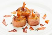 Scallops wrapped in bacon and seared, close-up