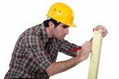 Man marking wood