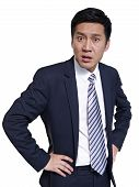 image of outrageous  - studio portrait of an angry asian businessman - JPG