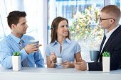 picture of work crew  - Colleagues on coffee break in business office - JPG