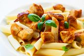 Pasta with roasted meat, tomato sauce and vegetables