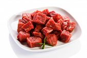 stock photo of veal meat  - Raw beef on white background - JPG