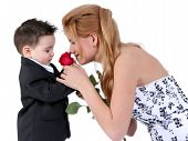 Adorable Boy Smelling Rose With Beautiful Teen Girl