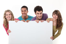 picture of peppy  - Teenagers holding up a blank sign - JPG
