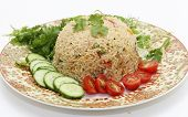 A healthy tomato (thakkali) biriyani with a salad of cucumber, cherry tomatoes and some fresh leaves