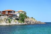 modern villas located on a cliff above the sea
