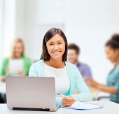 business, education and technology concept - asian businesswoman or student with laptop and document