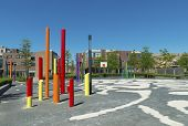 picture of entryway  - modern school yard with artistic colored poles - JPG