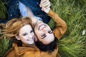 stock photo of kiss  - Above shot of a young couple in the countryside - JPG