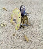 Old Mechanical Watch On The Sand.