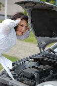 Desperate Woman With Broken Car