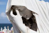 Sad Statue in Cemetery