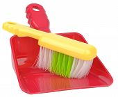 A dustpan and brush