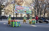 Clowns pushing parade sign in 2013 Macy's Parade