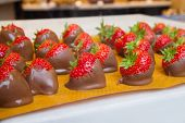 Strawberries Coated In Melted Brown Chocolate