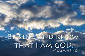 Be still and know that I am GOD. Bible quote from Psalm 46:10. Dramatic clouds in background.