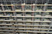 stock photo of scaffold  - High angle close up view of the front facade of a highrise multi - JPG