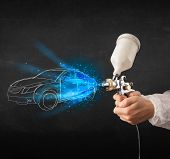 image of gun shop  - Worker with airbrush gun painting hand drawn white car lines - JPG