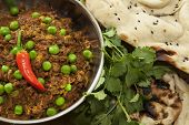 Kheema and naan bread with coriander and chilli