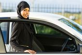 attractive arabian girl getting in a car