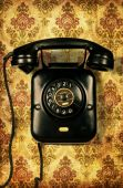 Retro Telephone On Vintage Wallpaper