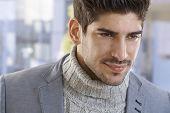 Closeup portrait of goodlooking young casual man, smiling.