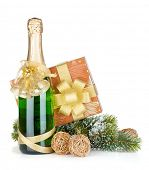 Champagne bottle, christmas gift and snowy firtree. Isolated on white background