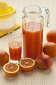 Fresh blood orange juice in a jar