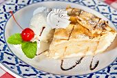 stock photo of cherry pie  - American apple pie with vanilla ice cream whipped cream cherry and mint twigs - JPG