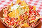 stock photo of scallion  - Vegan nachos with tomatoes black beans corn olives avocado and scallion - JPG