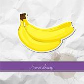 Ripe banana on crumpled paper