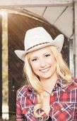 foto of cowgirls  - Portrait of Sensual Smiling Happy Blond Cowgirl wearing hat - JPG