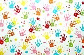 Colorful Children Hand Print On A Wall.