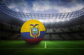 Football in ecuador colours in large football stadium with lights