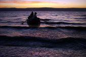 Two Galilee fishers on a boat, Galilee Sea, Israel