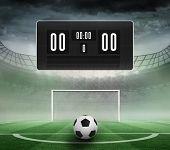 stock photo of football pitch  - Black scoreboard with no score and football against football pitch in large stadium - JPG