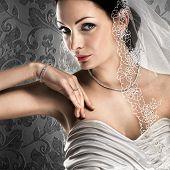 Elegant bride with diamond jewellery on vintage background