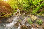 Relaxation joga in forest at the Waterfall. Virabhadrasana pose