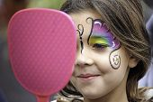 Face Painting Girl Looking At Mirror