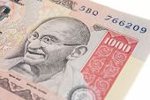 stock photo of gandhi  - The portrait of Gandhi on a one-thousand Indian rupee note.