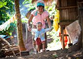 MAE HONG SON, CHIANG MAI, THAILAND - DEC 4, 2013: Unidentified Palong woman with her baby from ethni