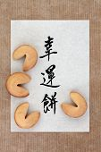 Fortune cookie group on rice paper. Translation of chinese calligraphy script reads as fortune cookie.