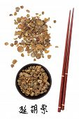 Corydalis tuber chinese herbal medicine and chopsticks. Translation of chinese calligraphy script is