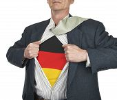 Businessman Showing Germany Flag Superhero Suit Underneath His Shirt