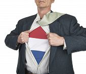 Businessman Showing Netherlands Flag Superhero Suit Underneath His Shirt