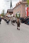 Miesbach / Germany / Bavaria - 05.May: Mountain protect company Aschau  with drummer train and brass