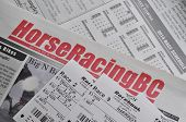 COQUITLAM, BC, CANADA - May 8, 2014 : Horse racing newspaper and racing tickets background in Coquitlam BC Canada.