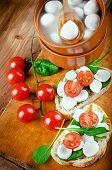 Mozzarella tomatoes and bread. Italian food